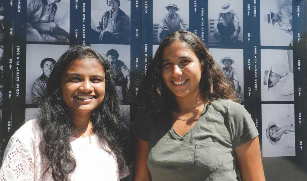 Sherin Aboobucker (first year), left, and Noa Richard (first year), right, outside of Haines Hall at Occidental College in Los Angeles